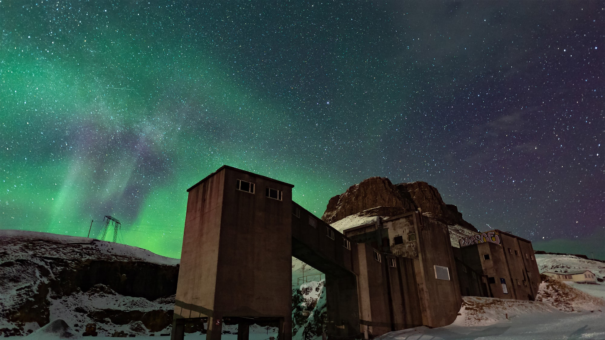 steve collins sony alpha 7SII aurora and stars hang over a wooden building in iceland