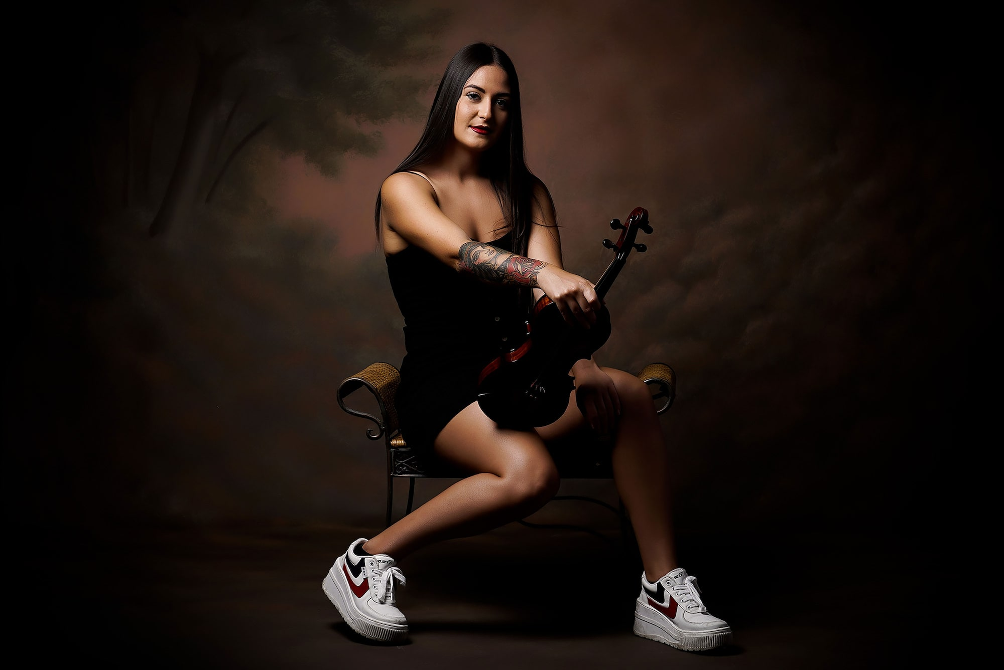 jose m mercado sony alpha 7S female violinist posest formall against a dark background