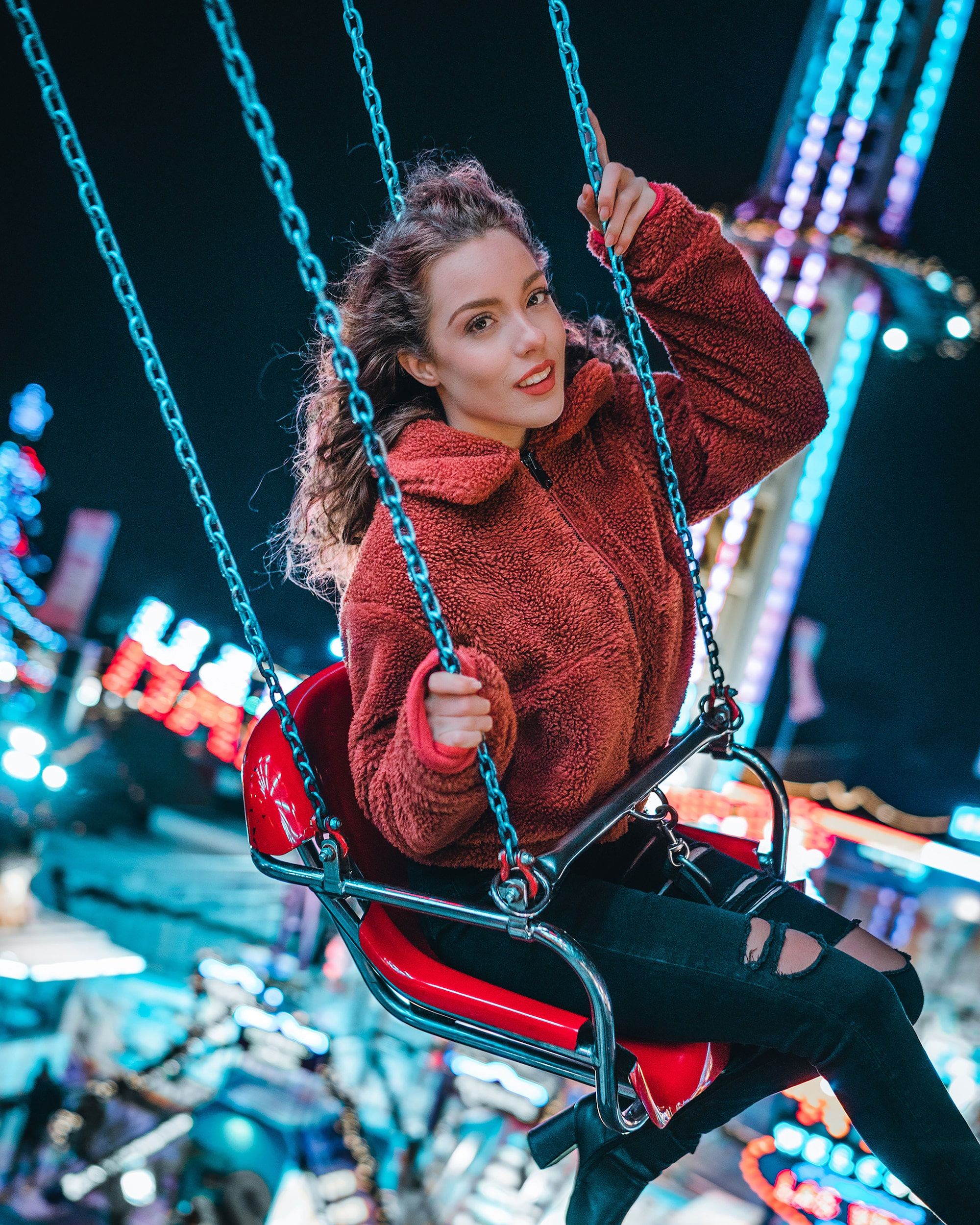 mike will sony alpha 7RIII girl on a fairground ride holding on tight as it spins round