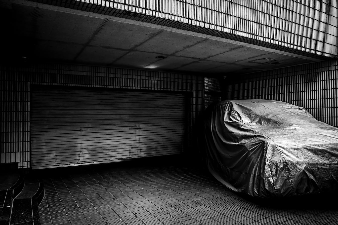 Gábor-Erdelyi-sony-covered-car-outside-garage