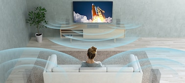 Woman watching television in living room with illustrations of sound waves..
