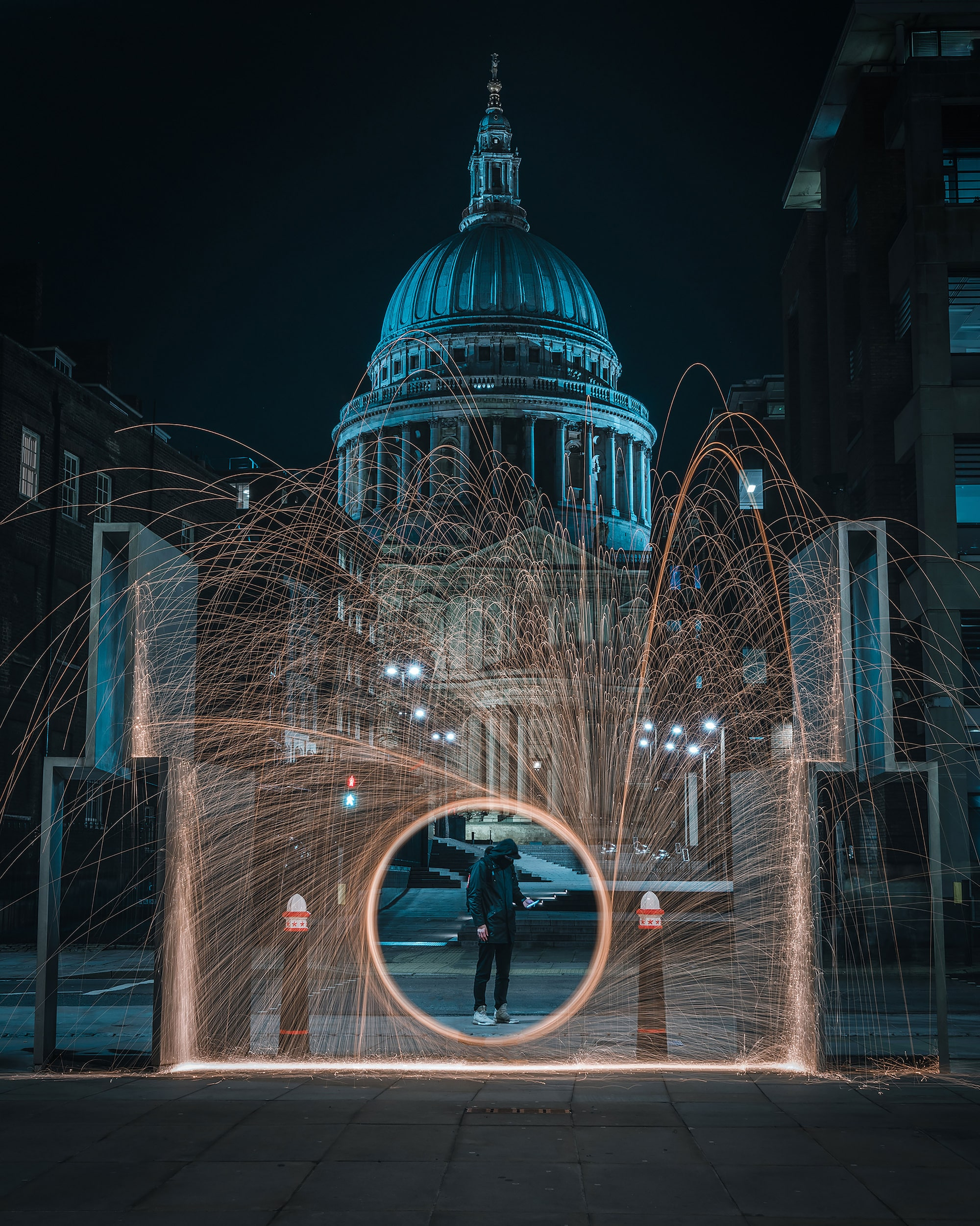 mike will sony alpha 7RIII man stands behind spinning lights in front of st pauls cathedral
