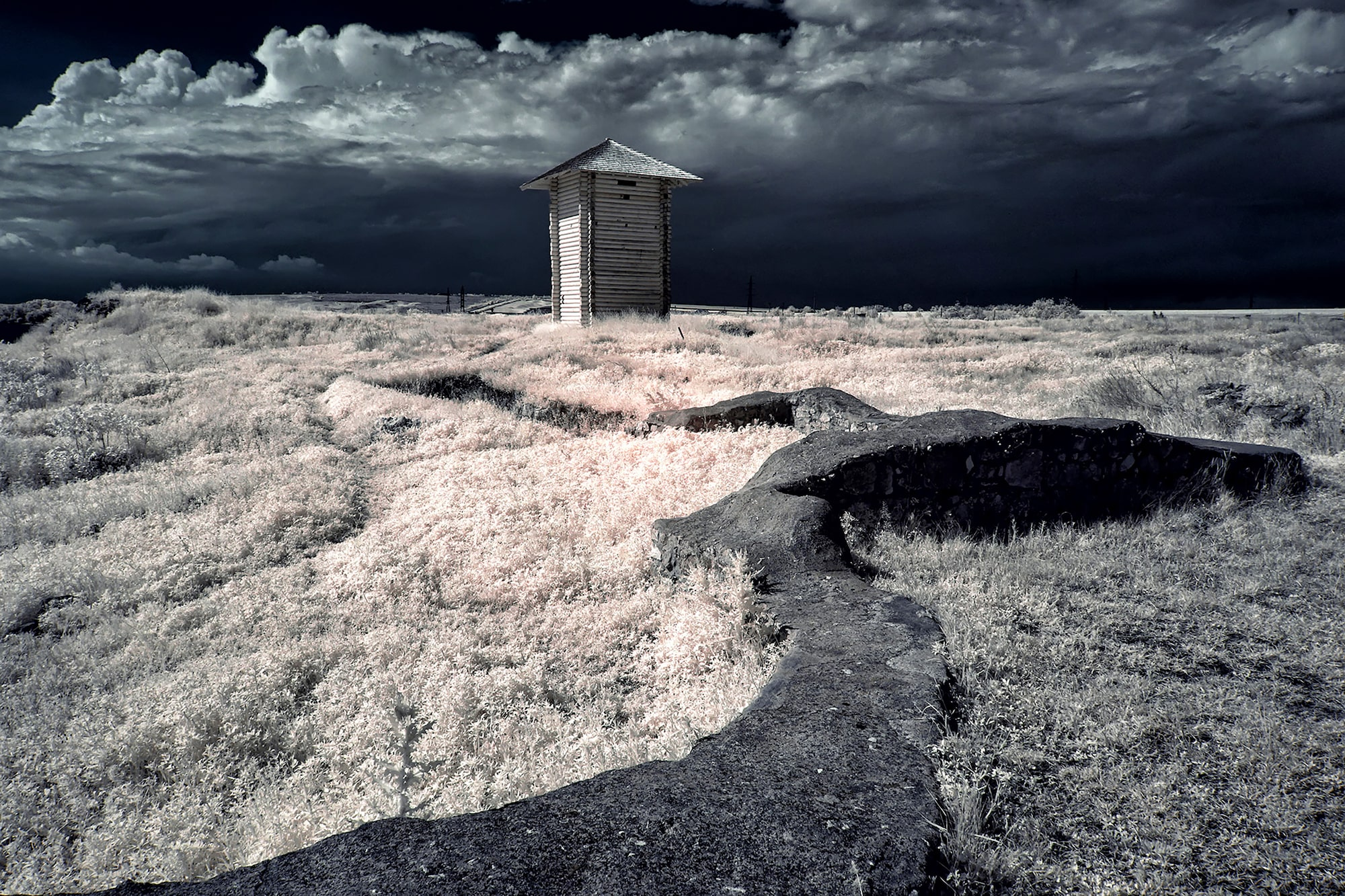 alin popescu sony alpha 6000 infrared shot of a small building in the middle of a field
