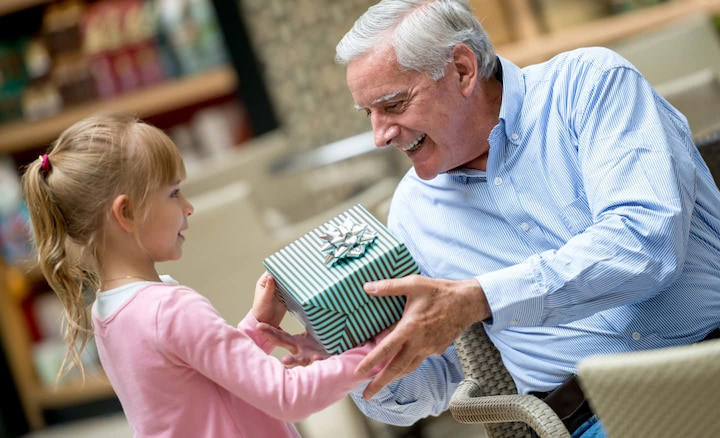 Girl presenting her grandfather with the SRS-LSR200