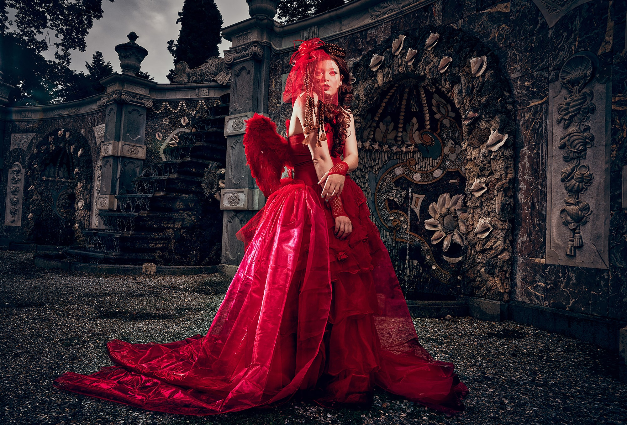 frank doorhof sony alpha 7RII lady wearing a red dress poses in front of a gothic building
