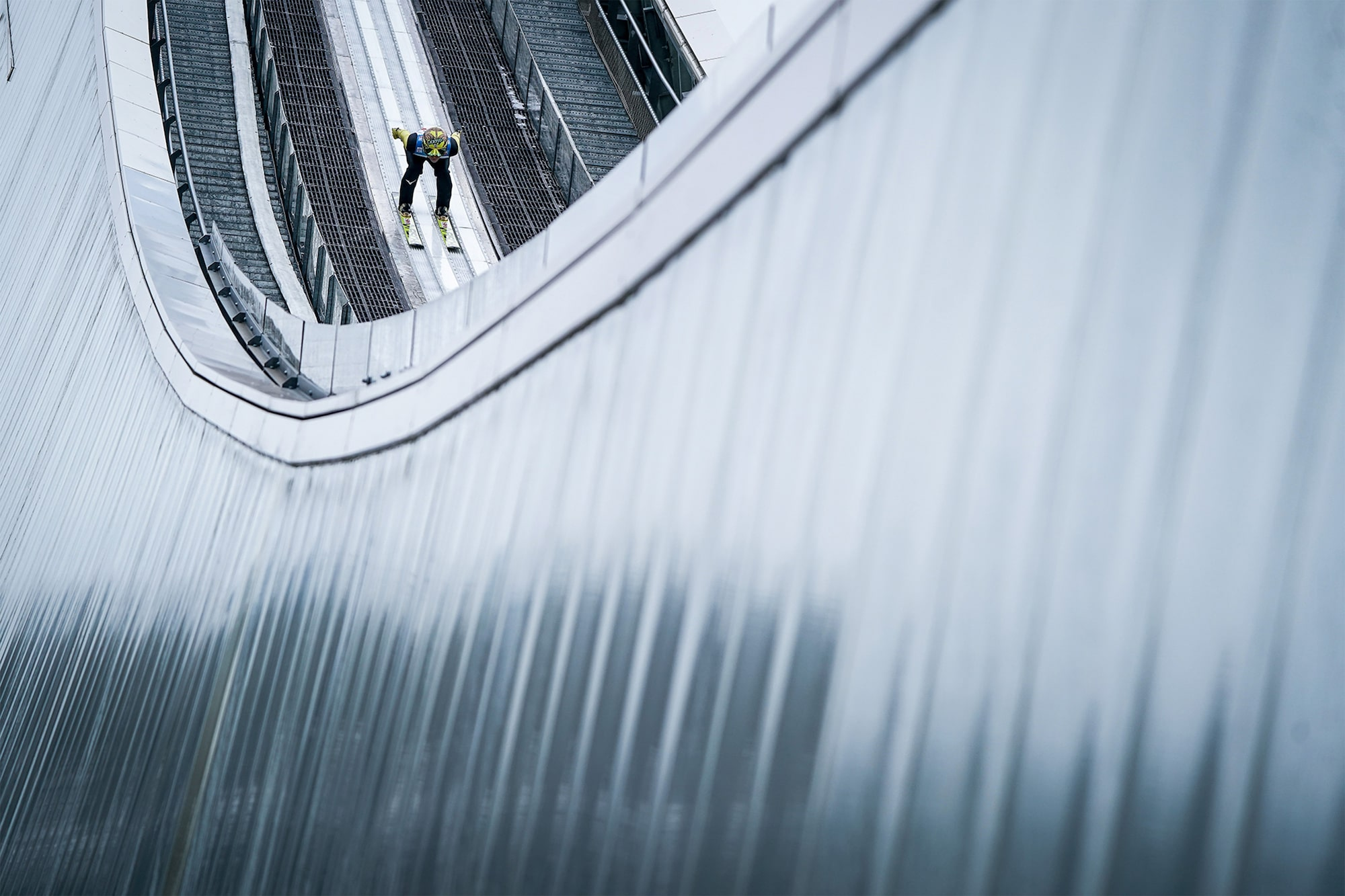 tomasz markowski sony alpha 9 ski jumper hurtles down a track before taking off