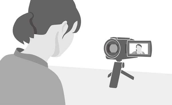 Image of a woman watching footage on the Sony Handycam's monitor