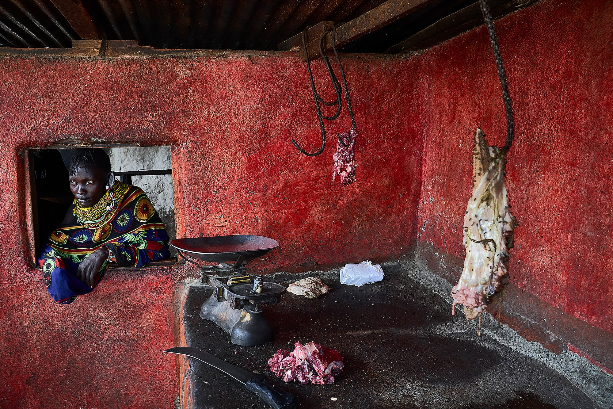 tomasz tomaszewski sony alpha 7RM3 inside a kenyan hut kitchen with meat hanging on hooks