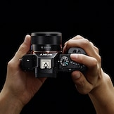 Camera shown in hands
