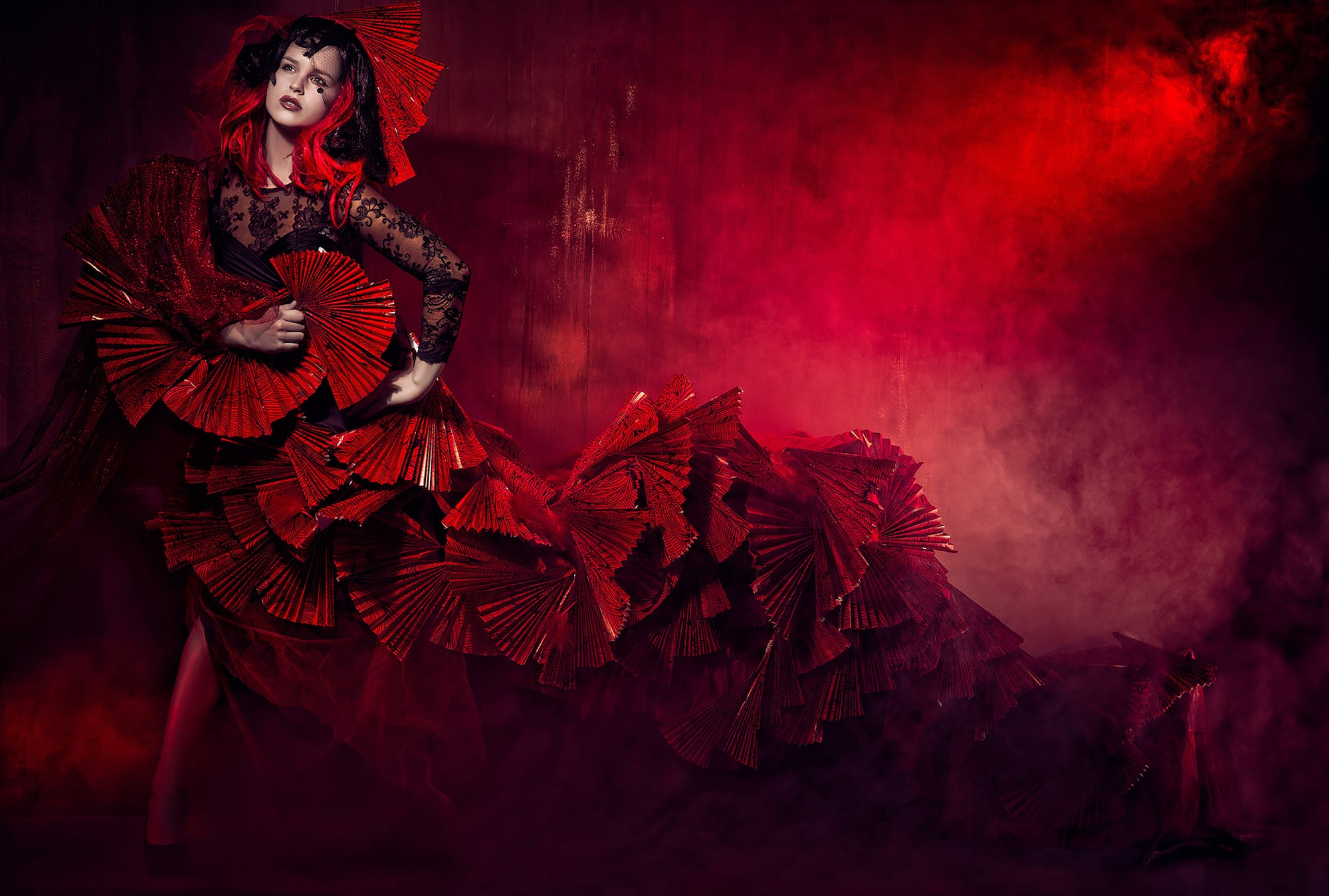 frank doorhof sony alpha 99 lady in a red dress made from paper fans with red smoke in the background