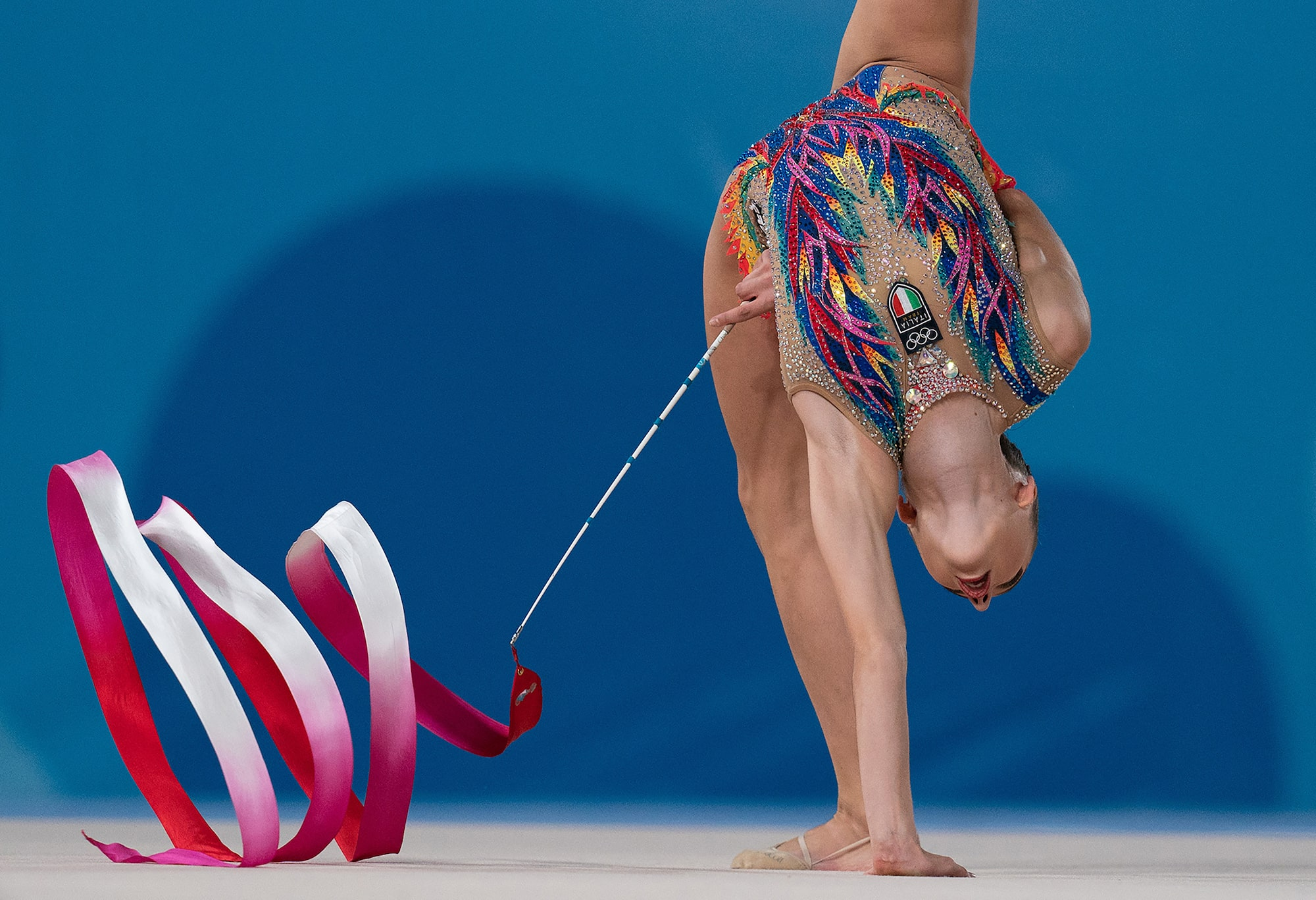bob martin sony alpha 9 gymnast bends completely over while twirling her ribbon