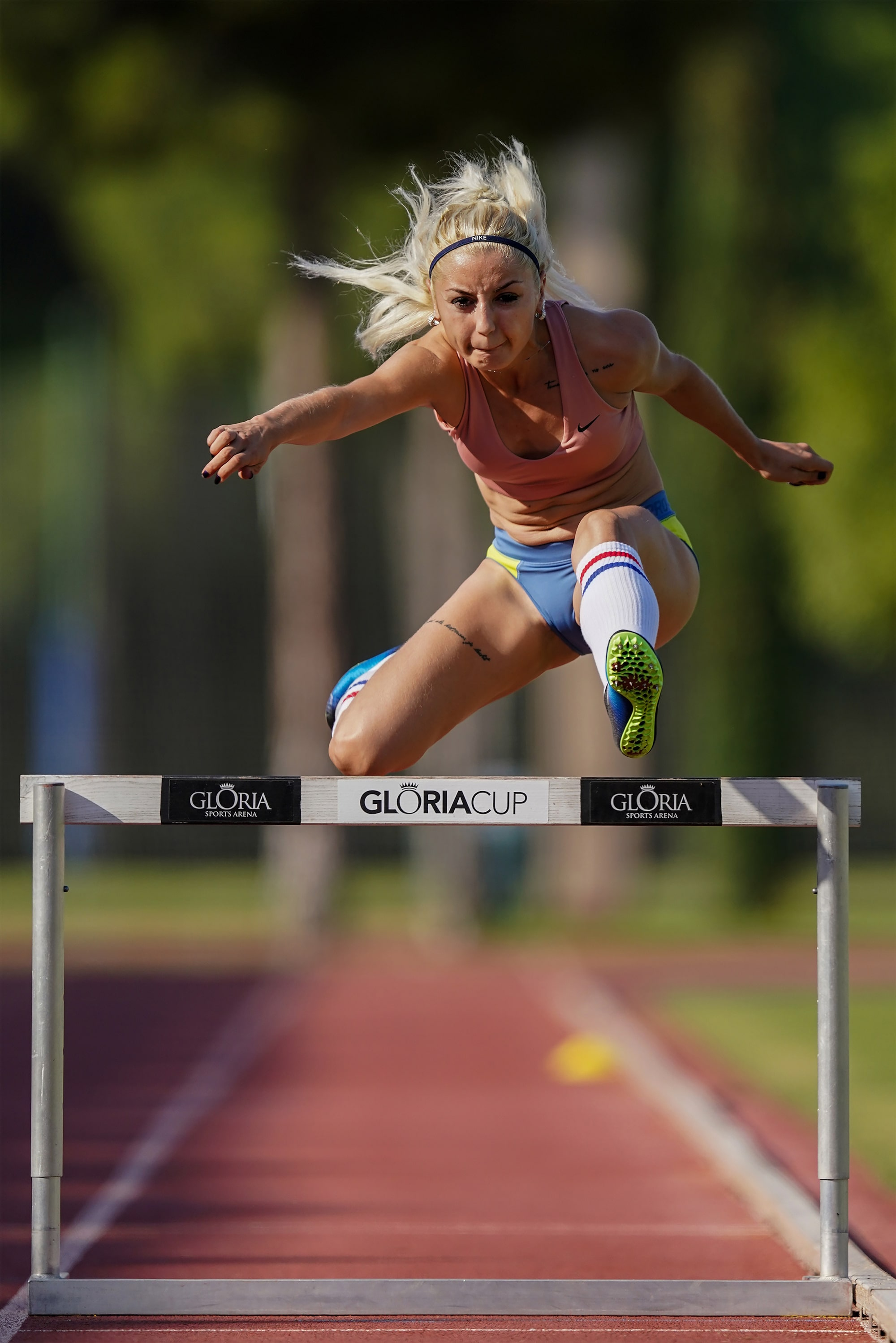 bob martin sony alpha 9II runner caught in mid jump over a hurdle