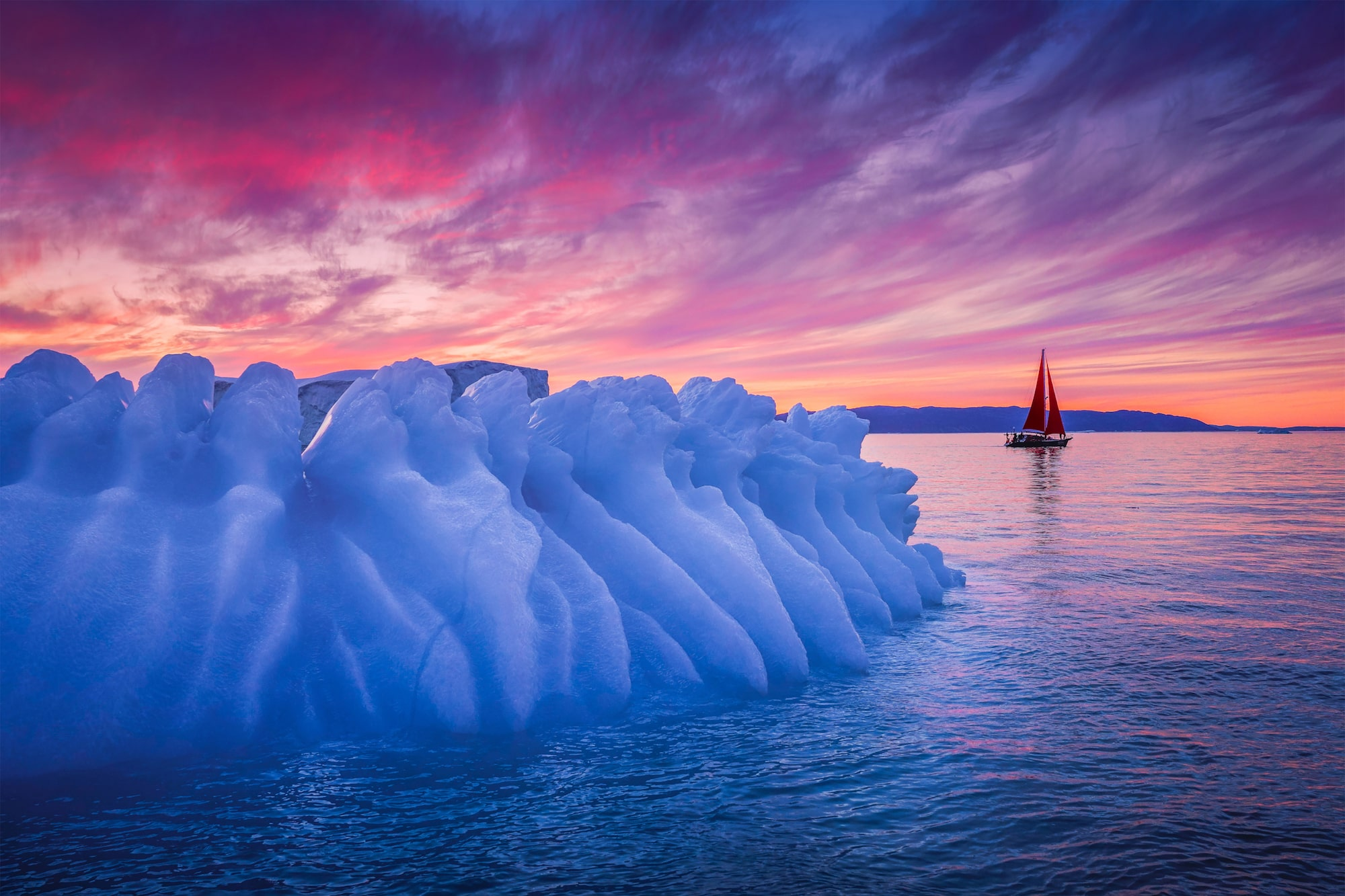 albert dros sony alpha A7RM4 sunset over a blue iceberg in greenland
