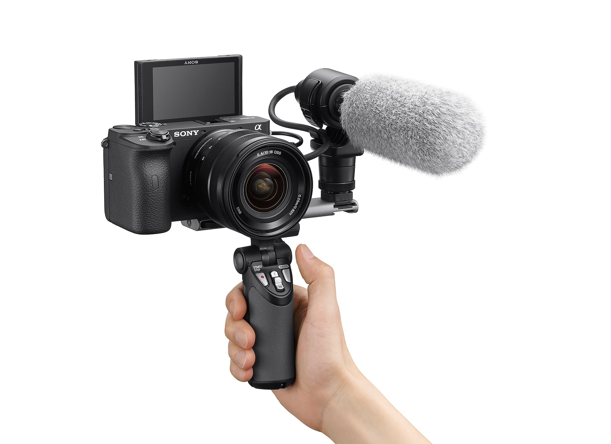 Sony A6600 with microphone attached being held facing the videographer