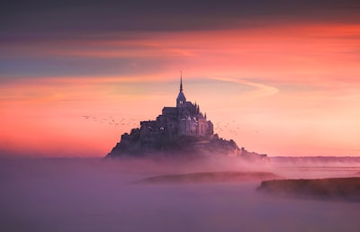 ilhan eroglu sony alpha 7R mont st michel through the mist with birds flying above