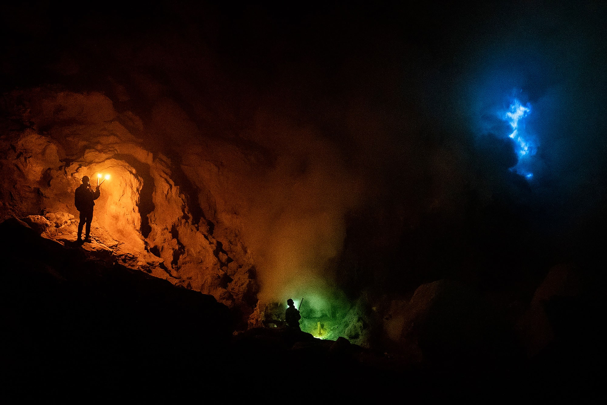 andrea frazzetta sony alpha 7SII miners inspect the inside of the mine with coloured torches