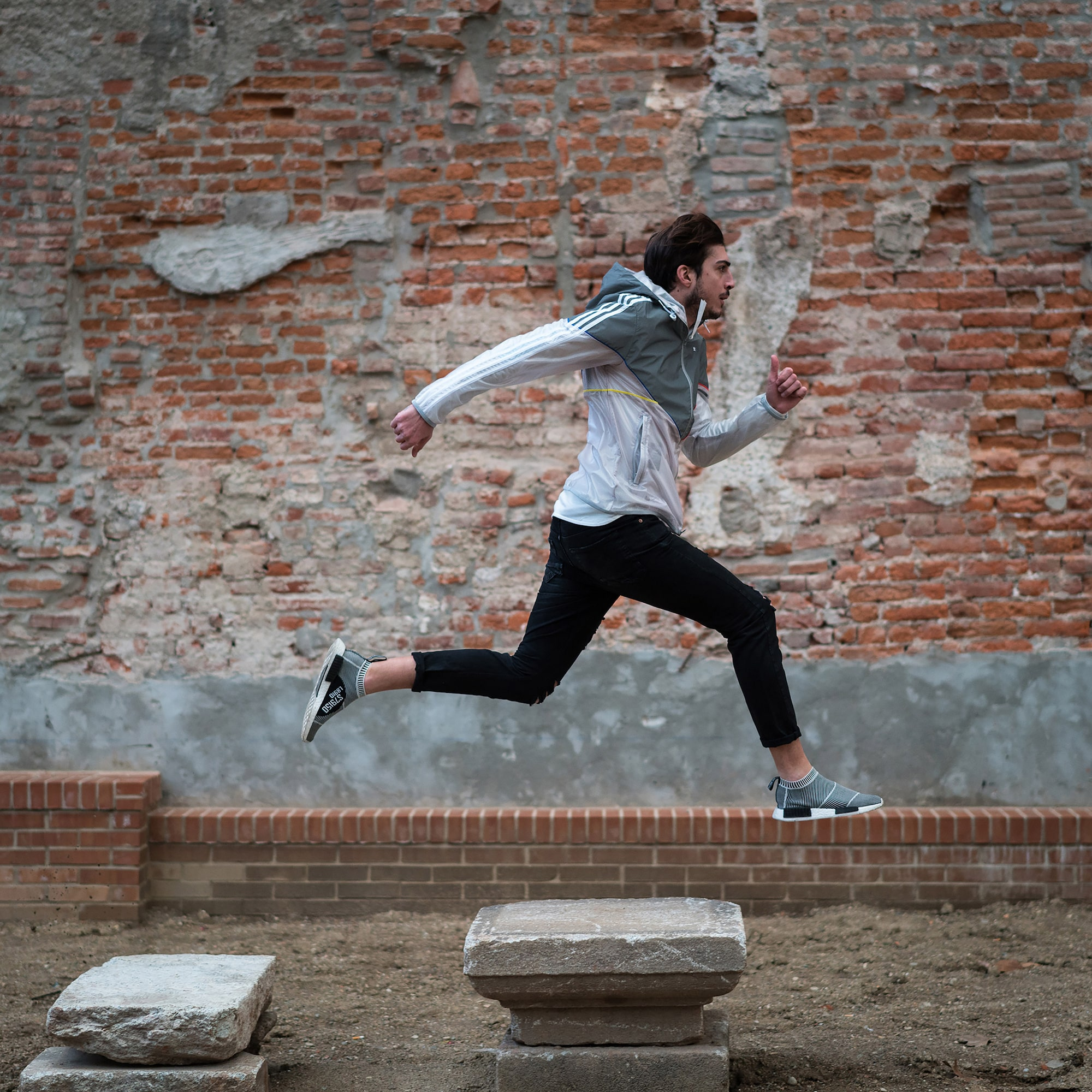 amedeo novelli sony alpha 7RII man leaping across paving stones in mid air