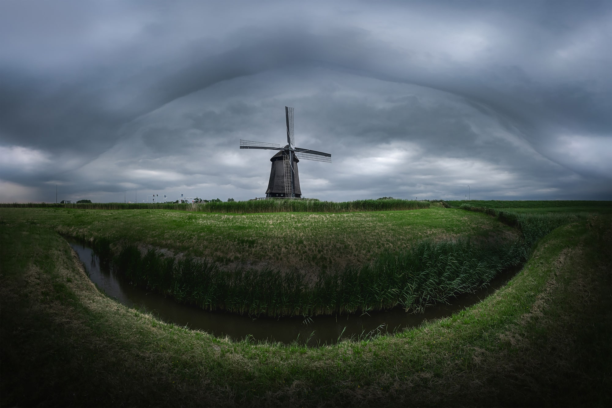 albert dros sony alpha 7RM4 panoramic view of a windmill in the netherlands with dramatic stormy skies behind